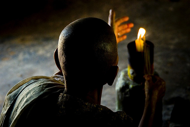 Buddhist monk praying in Angkor, Cambodia