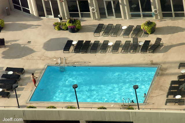 View of a rooftop swimming pool from the 27th floor of a high rise at huron street and michigan for Houston swimming pool high rise