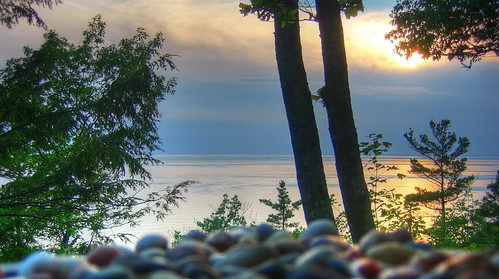 sunset cloud lake tree silhouette rocks stones michigan horizon pebbles lakemichigan hdr foreground