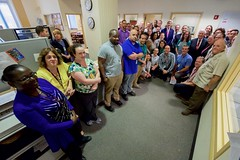 U.S. Secretary of State John Kerry poses for a photo with employees at the Passport Agency Office in the U.S. Custom House in Philadelphia, Pa., after delivering a speech on September 2, 2015, about the Iranian nuclear deal at the nearby National Constitution Center. [State Department photo/ Public Domain]