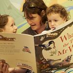 Reading with mum | Enjoying some stories in the Children's Bookshop © Helen Jones
