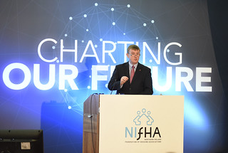 Social Development Minister Mervyn Storey MLA addresses the audience at the Annual NIFHA Conference.