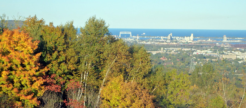 lift bridge in the distance, colorful trees in the foreground