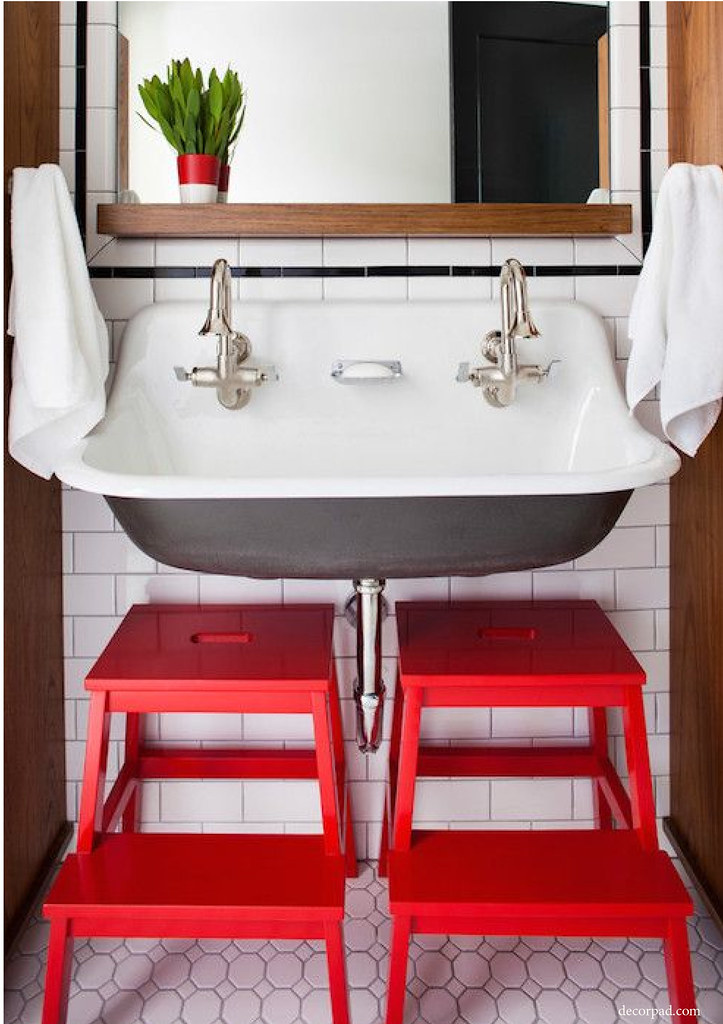 two red stools in a powder room add pizzaz
