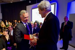 Switzerland Head of Department of Foreign Affairs Didier Burkhalter presents U.S. Secretary of State John Kerry with chocolate and other Swiss gifts as the Secretary makes his last visit to the World Economic Forum in Davos, Switzerland, on January 17, 2017. [State Department photo/ Public Domain]