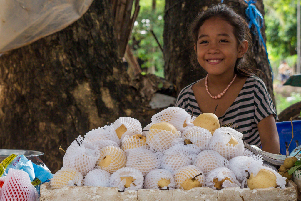 A smiling girl at the fresh produce market near Hariharalaya in Siem Reap, Cambodia-2