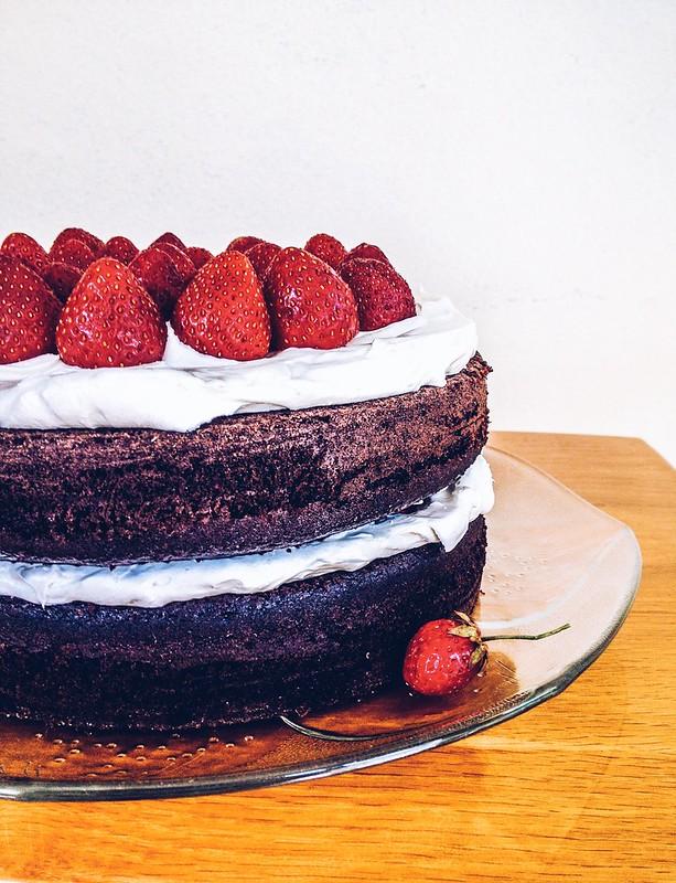 Vegan chocolate strawberrt cake with whipped coconut cream