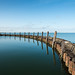 Old breakwater on a windless day by RuudMorijn