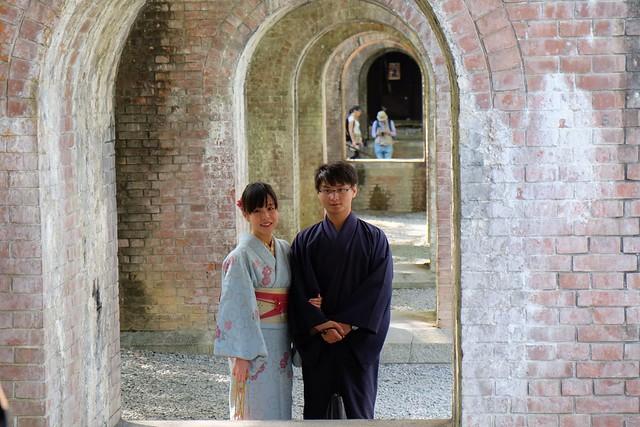 Japanese couple under the aquaduct at Nanzenji Temple