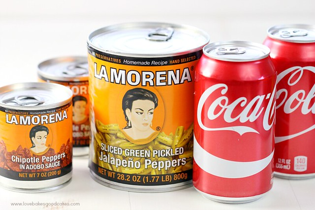 Cans of La Morena peppers and two cans of Coca Cola.