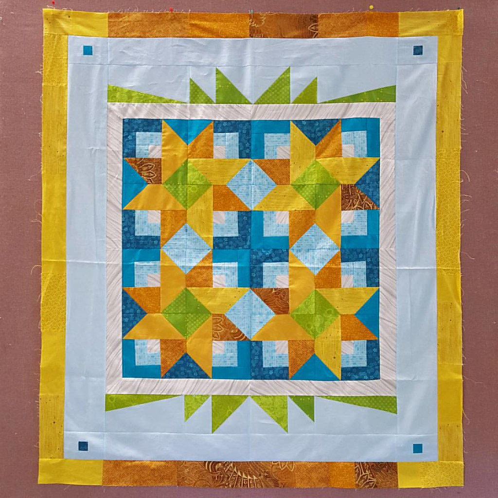 I finished up one of my WIP quilt tops at our quilt retreat. Now that I see this photo, I think I want to add a row of dark mustard on the top and bottom.