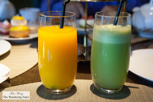 Fresh pressed orange juice and apple-carrot juice