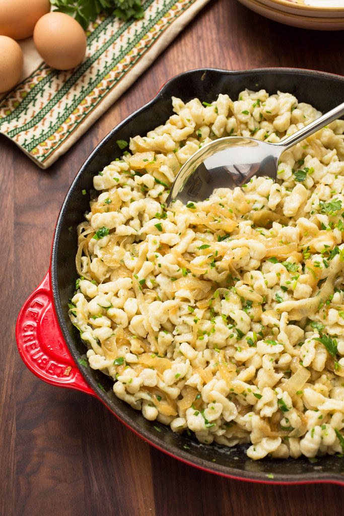 Spaetzle tossed in pan with onions and herbs
