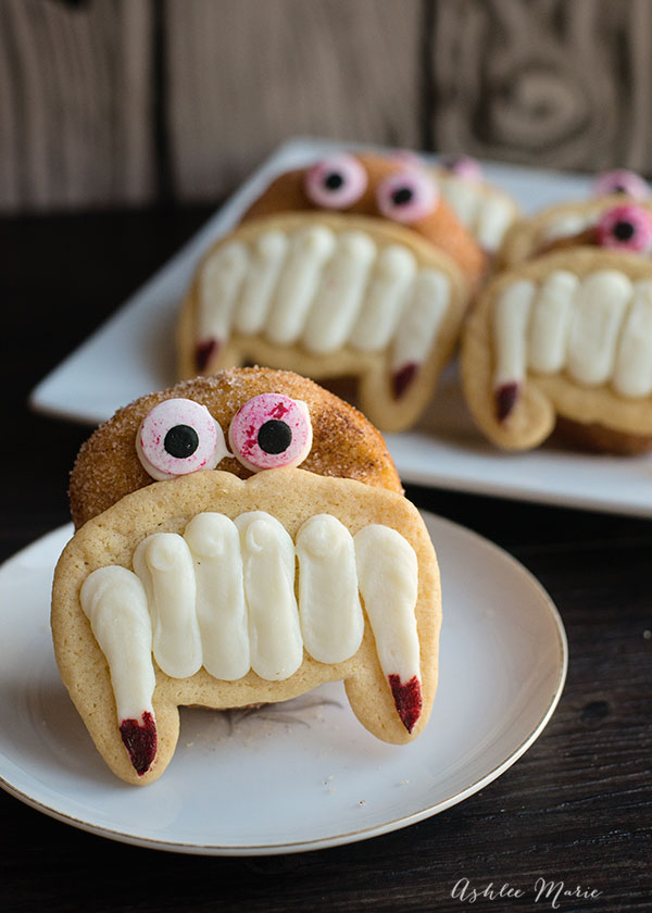 Monster doughnuts with sugar cookie and ganache fangs