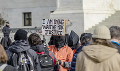 David Barrows Holds a Sign During an Anti-Torture Rally on the 15th Anniversary of Guant�namo's Opening