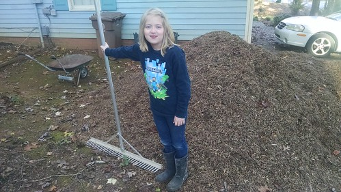 Catie next to the mulch pile (doesn't really show just how huge it was)