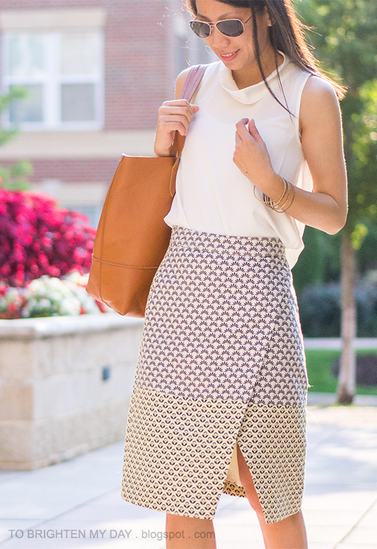 white sleeveless cowl top, brocade wrap skirt, cognac brown tote, mixed bangles
