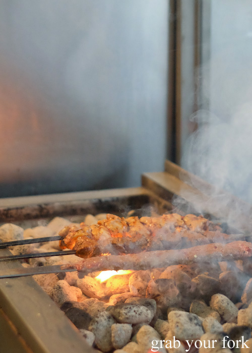 Shish kebabs cooking over charcoal at New Star Kebabs, Auburn