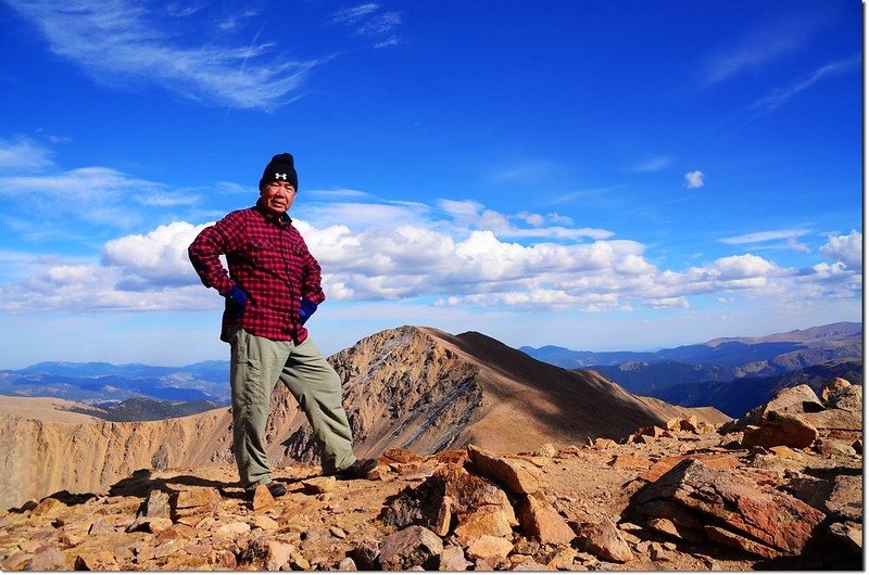 Me on the summit of Parnassus, in the background is Bard Peak