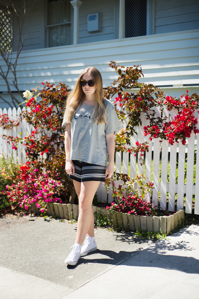 StolenInspiration.com | Kendra Alexandra | New Zealand Fashion Blogger | Lonely Hearts Tshirt, Stripe Knit Shorts, Karen Walker Anytime Sunglasses, White Converse Hightops, Michael Hill Necklaces