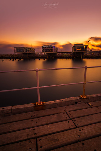 longexposure sunset buildings dock pier sea seascape smooth water march afternoon gold cyprus sony sonya6000 ilce6000 samyang samyang12mmf20ncscs haidafilter bulb manfrottobefree