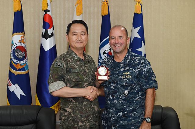 Vice Adm. Hyun Seong Um, (left), commander, ROK fleet, meets with Rear Adm. James 'Jim' Kilby, commander, SMWDC