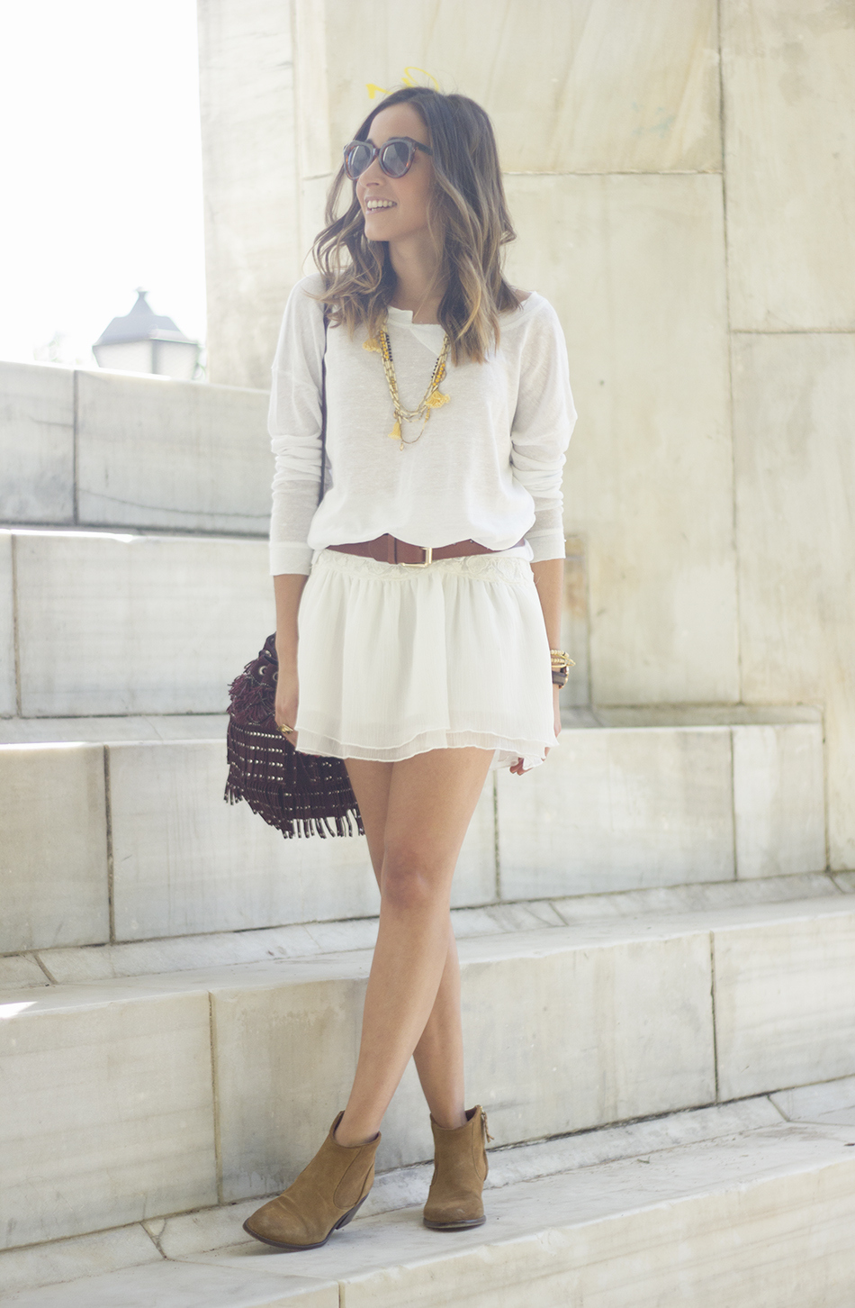White casual outfit with brown booties and burgundy bag14