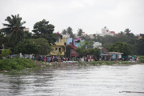 River Adyar flowing precariously close to settlements along its right bank. Hundreds of families living along the river and lake banks were shifted to safety as soon as the flood warning was issued by the Met department