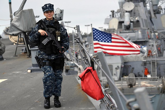 Sailor stands topside rover watch aboard USS Porter while the ship is pierside at Naval Station Rota, Spain.