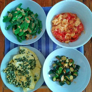 We used up the vegetables (and random stuff in the fridge) at dinnertime. Clockwise from top left: runner beans with miso butter, egg and tomato, courgettes with Lao Gan Ma sauce, purple bean omelette. All served with rice.