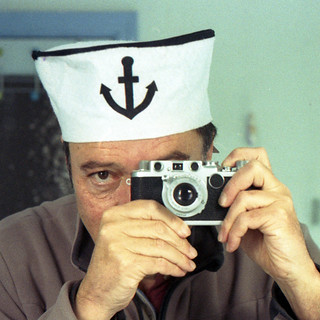 reflected self-portrait with Leica IIf camera and sailor hat (square crop)