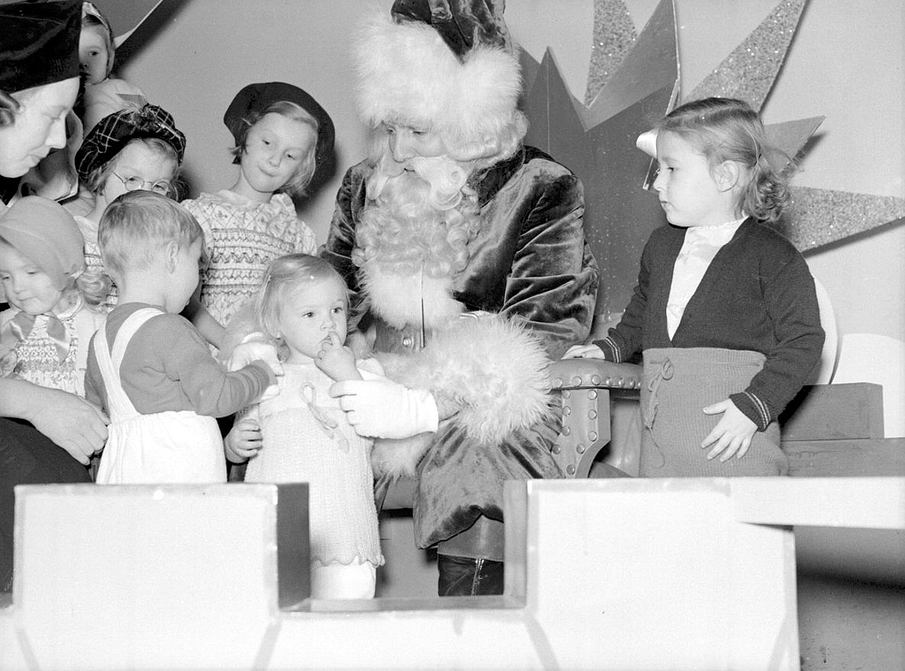 Children visiting Santa Claus, Eaton's department store, St. Catherine Street, Montreal, Canada, 1941