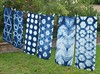 I was able to get yesterday's  #indigodyed scarves washed and dyed today, in spite of the rain. I was trying for a darker #indigo blue, and that's what I got, Wahoo!! #itajime #shibori #fbp
