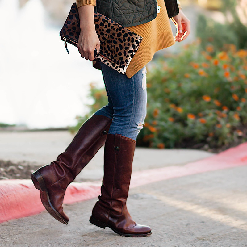 cute & little blog | army green quilted puffer vest, mustard sweater, distressed jeans, riding boots, leopard clutch | fall outfit