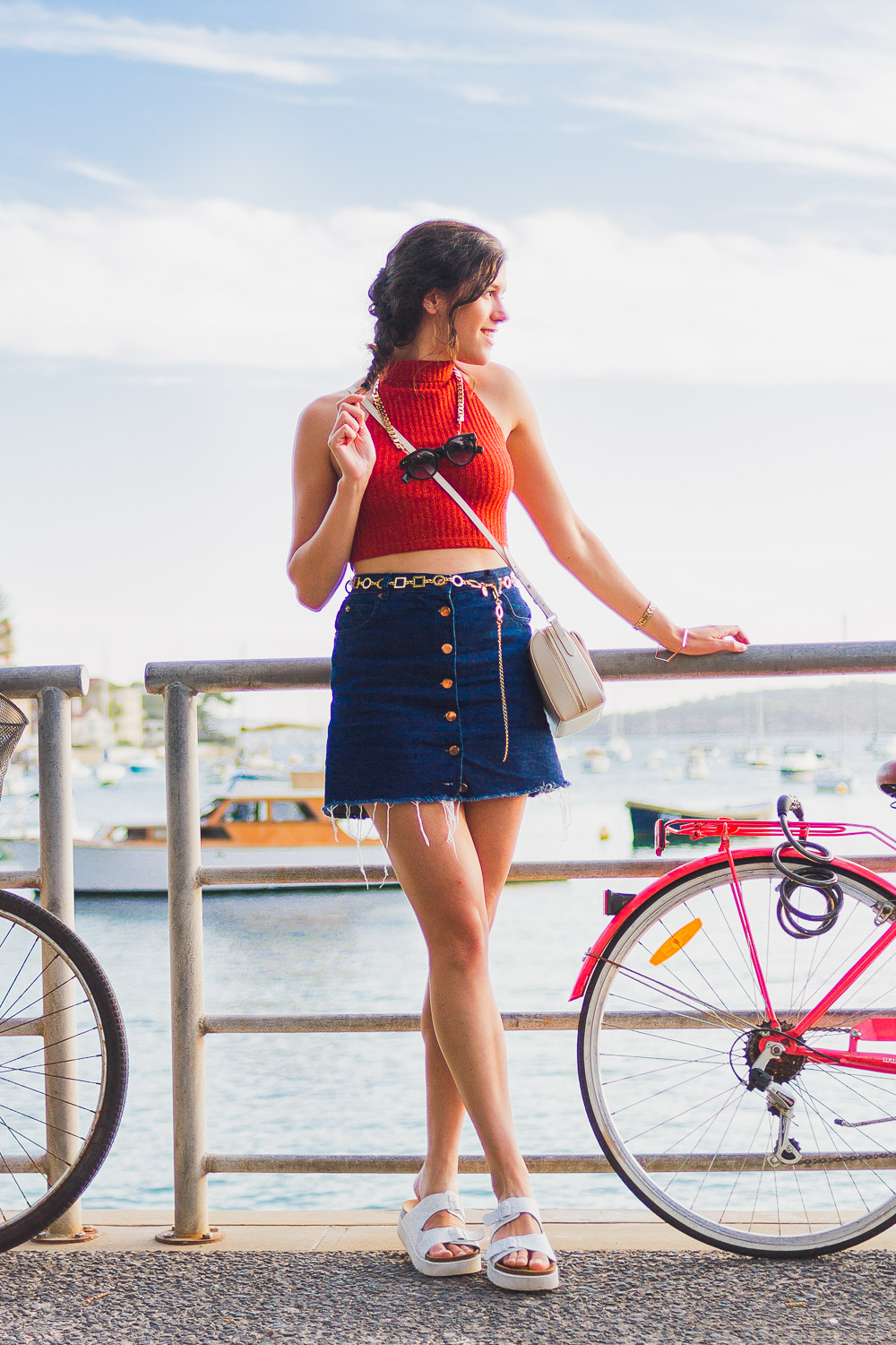 seventies style look with button up denim skirt, asos halterneck crop top and radley bag