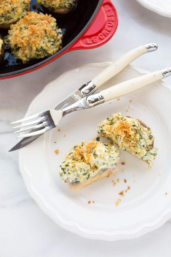 spinach and artichoke stuffed mushroom on plate