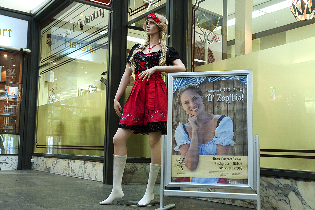 Female manikin in traditional dress outside haircutter--Leipzig
