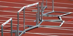 sprint(0.0), running(0.0), net(0.0), bicycle frame(0.0), physical exercise(0.0), athlete(0.0), athletics(1.0), track and field athletics(1.0), sport venue(1.0), 110 metres hurdles(1.0), obstacle race(1.0), 100 metres hurdles(1.0), sports(1.0), hurdle(1.0), line(1.0), hurdling(1.0),