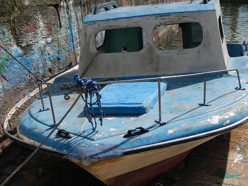 A blue boat in a town on the west coast of Galicia, Spain