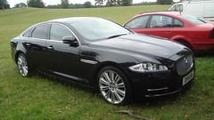 automobile(1.0), executive car(1.0), wheel(1.0), vehicle(1.0), performance car(1.0), automotive design(1.0), sports sedan(1.0), rim(1.0), full-size car(1.0), jaguar xf(1.0), sedan(1.0), personal luxury car(1.0), land vehicle(1.0), luxury vehicle(1.0),