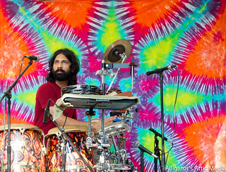Tie dye tapestry decorates the background of the Peace of Mind festival.