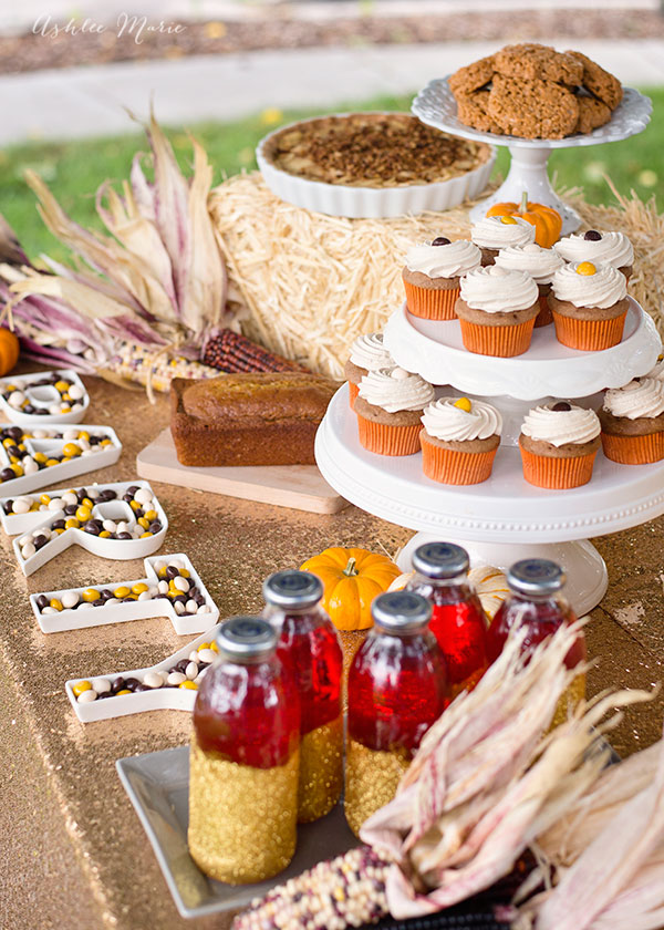 Add height to your party table with hay bales and cake stands. That way everyone can see all the food AND it looks much better straight on.