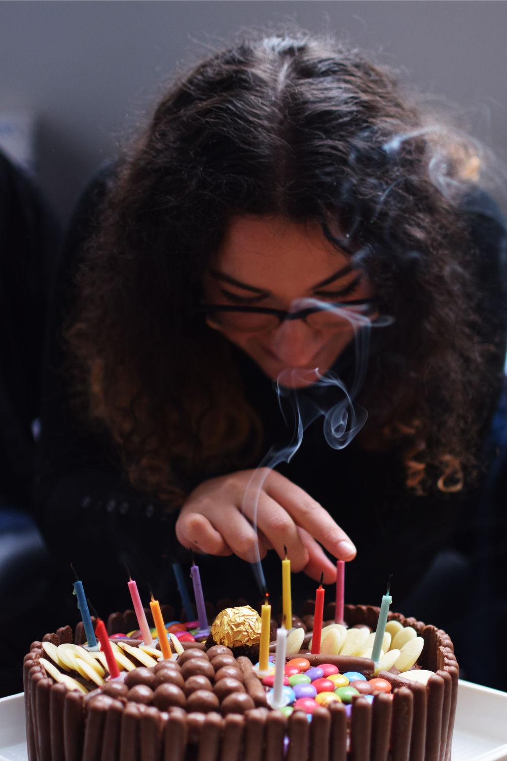 Birthday cake blowing out hte candles