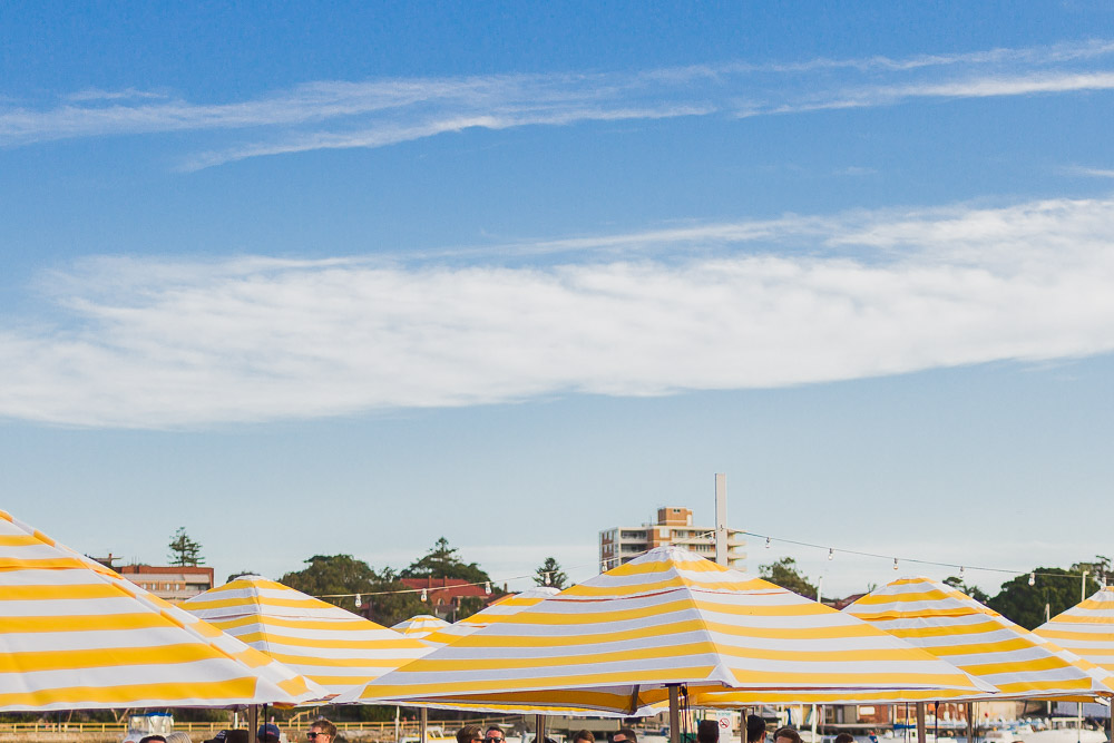 manly yellow parasols blue sky
