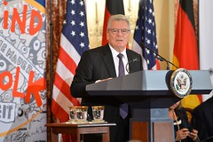 German President Joachim Gauck delivers remarks at an event to commemorate the arrival of a segment of the Berlin Wall that will be displayed in the U.S. Diplomacy Center, at the U.S. Department of State in Washington, D.C., on October 7, 2015. [State Department photo/ Public Domain]