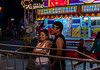 Watching their son on the bumper cars by Phil Marion