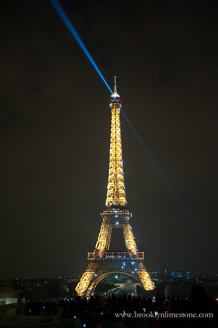 The Eiffel Tower lit up at night is spectacular to see when traveling Paris with Kids