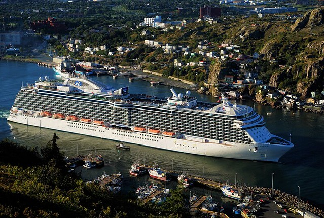 REGAL PRINCESS, glides between Prossers Rock small boat basin and the iconic battery.