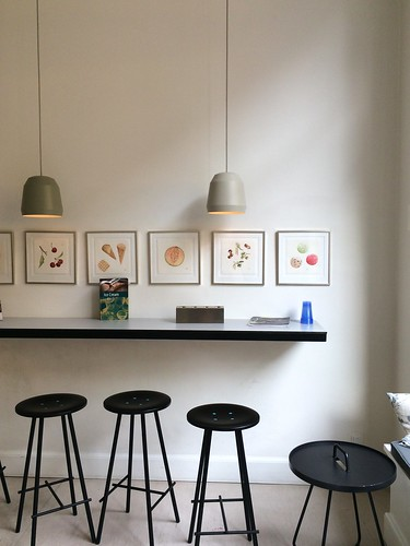 Copenhagen Østerberg Ice Cream counter with stools and watercolour fruit paintings