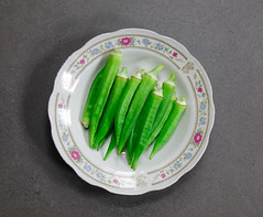 Boiled green of okra on the dish